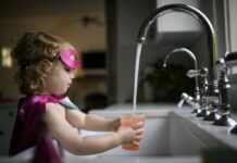 A girl gets a drink of water