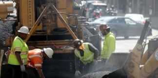 Workers tar a road in San Francisco