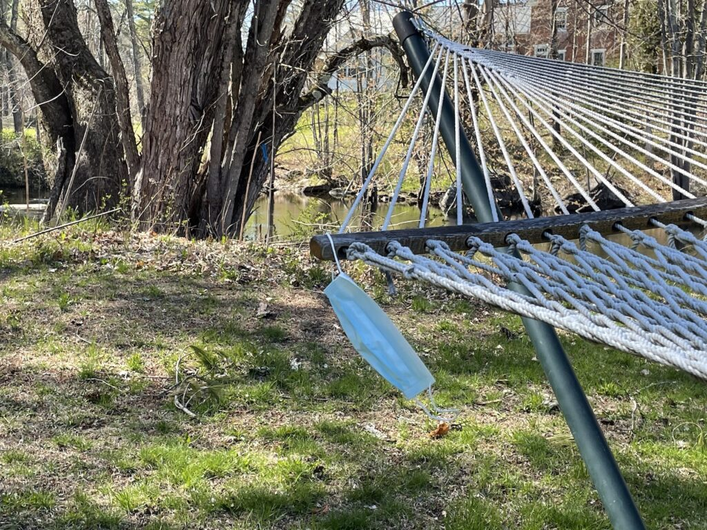 A mask hanging on a hammock