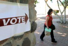 A woman walks outside toward a polling place