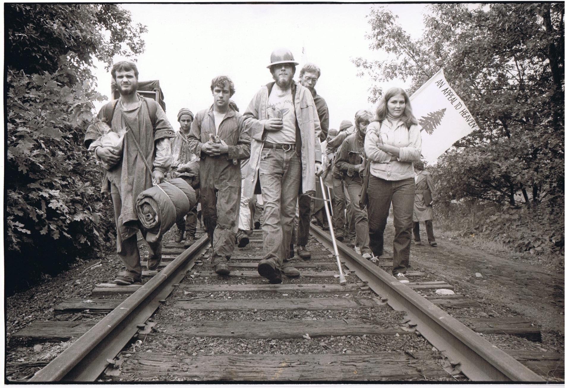 Clamshell Alliance members walk down railroad tracks