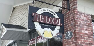 Sign for The Local restaurant in Warner