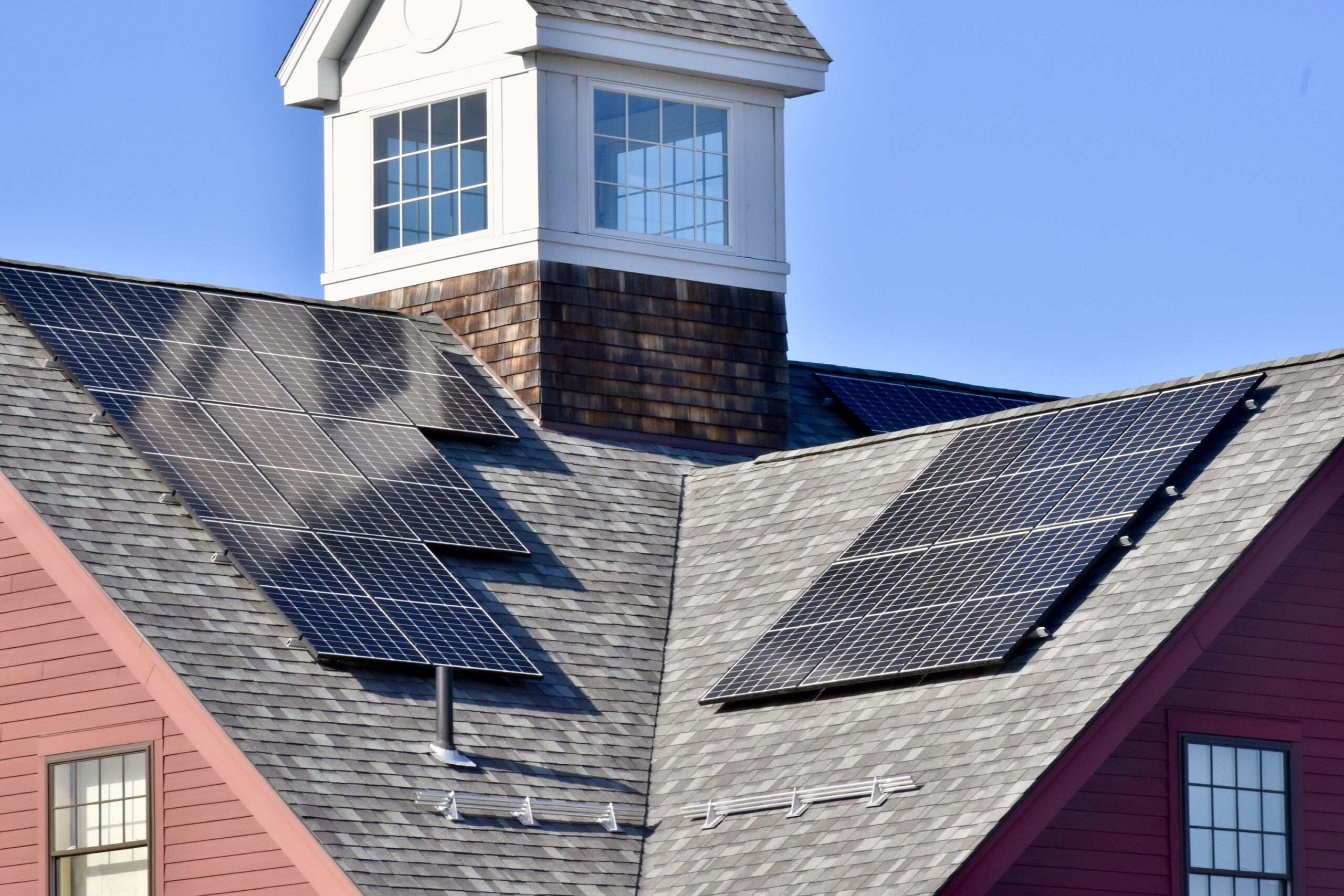 Solar panels on a building roof with a cupola
