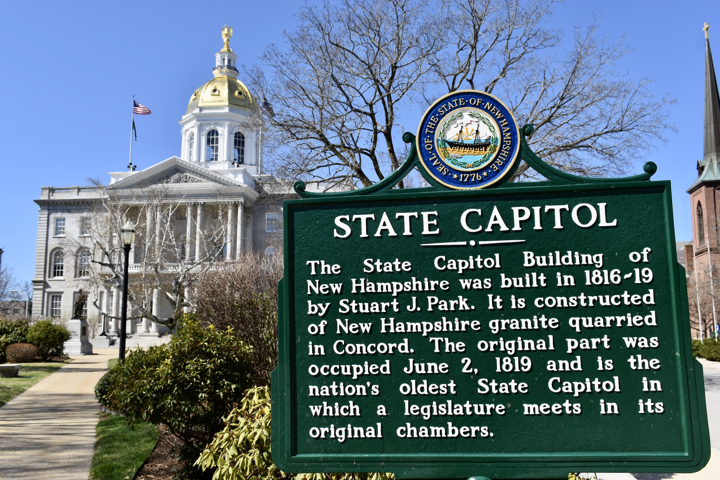 A historical marker in front of the State House