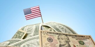 American flag planted in a pile of money