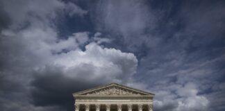 Exterior of the U.S. Supreme Court beneath dark clouds