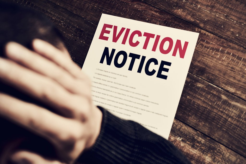 An eviction notice on a wooden table