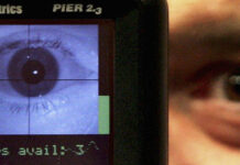 A close up of an eye being read by a biometric scanner