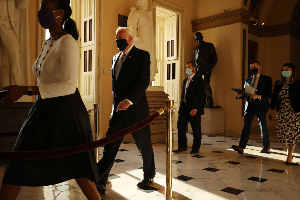 Steny Hoyer walks down a hallway in the Capitol