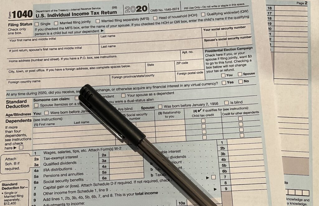 A tax form and a pen