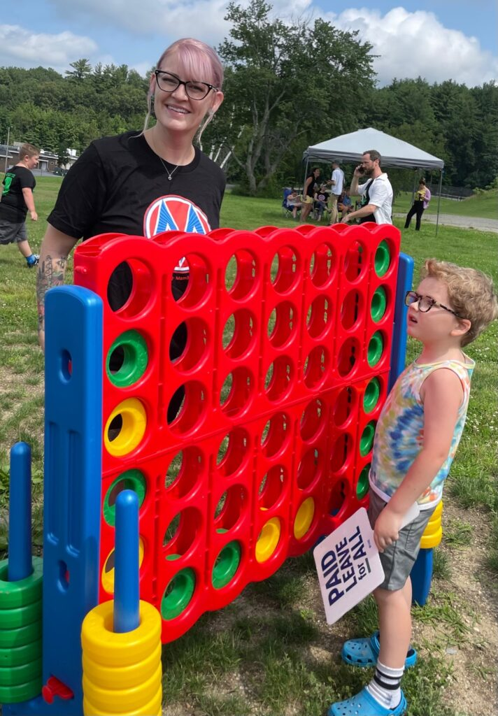 A woman poses with her son near playground equipment
