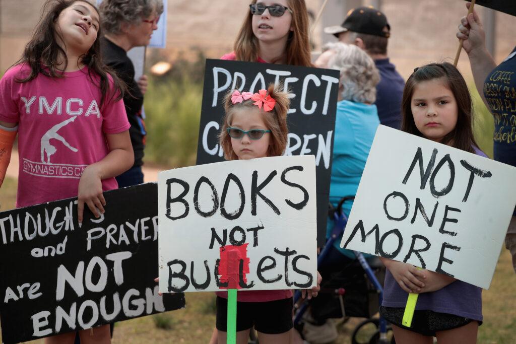 Children hold signs protesting gun violence