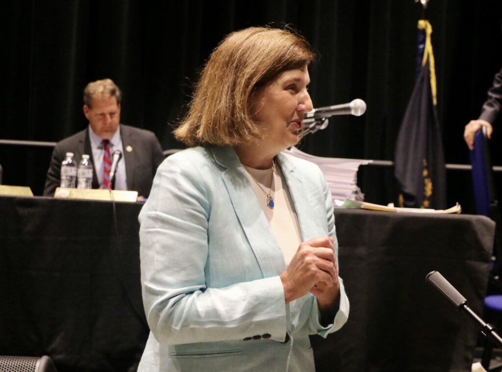 Cinde Warmington stands during an Executive Council meeting