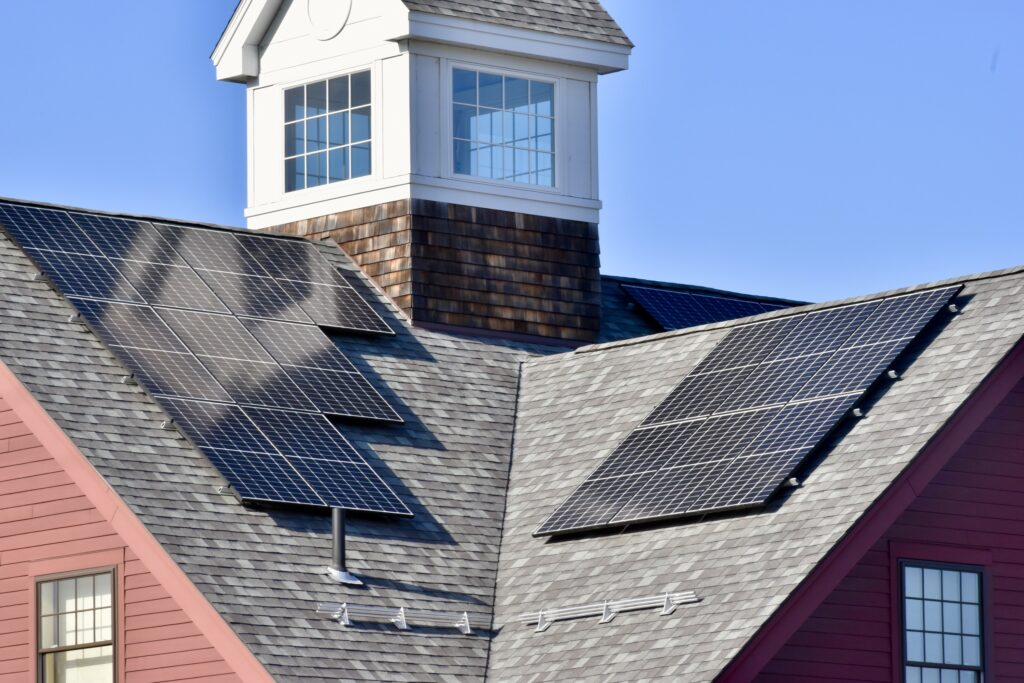 Solar panels on the roof of a brick building