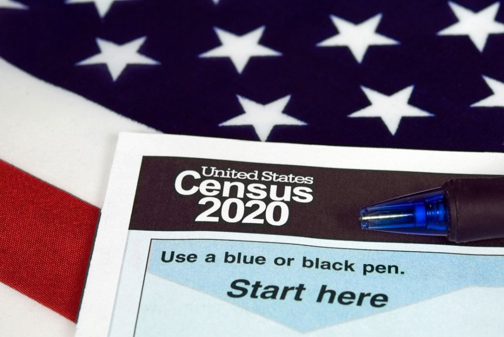 A census form with an American flag in the background