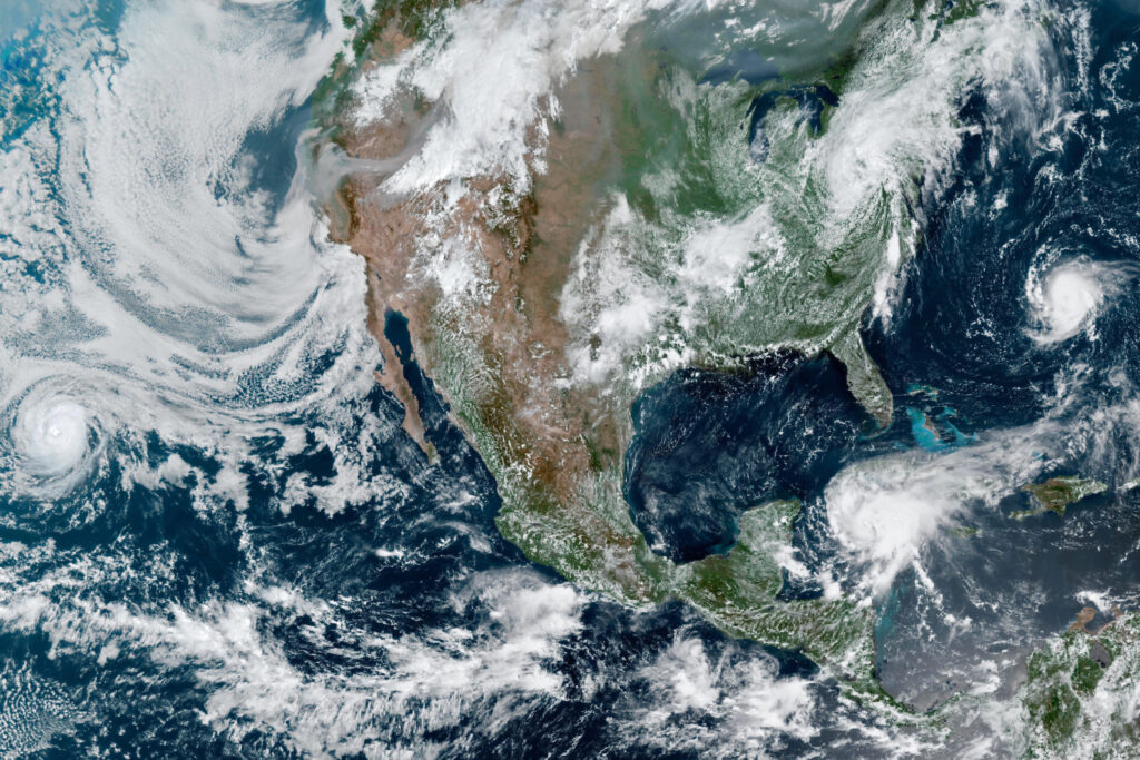 A satellite image of storms churning around North America