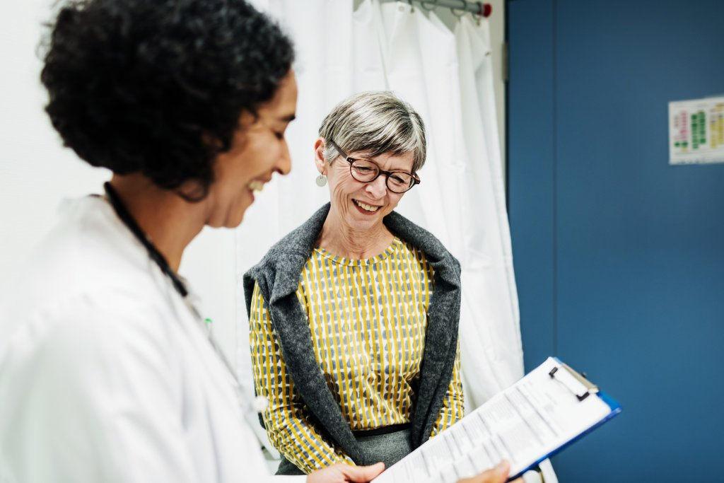 A doctor talks to an older patient