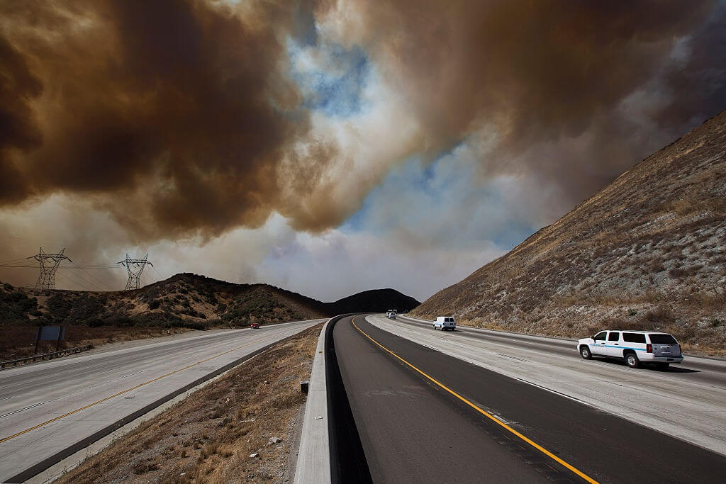 Wildfire smoke above a mostly empty highway out West