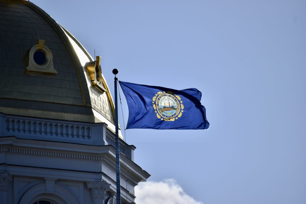 State House dome and the state flag