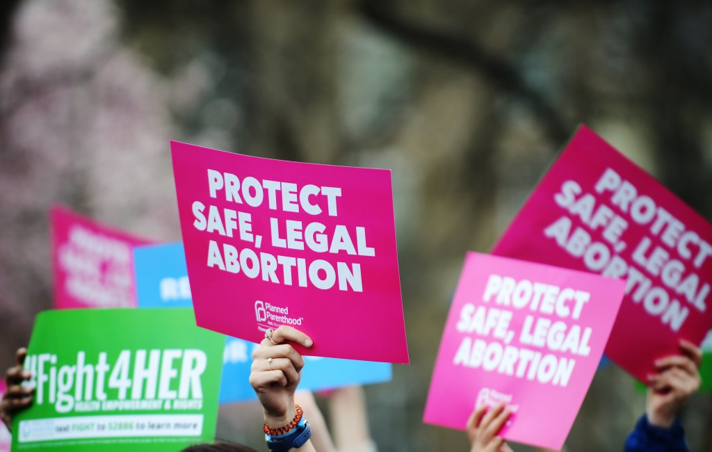 Pro-choice protesters hold up signs