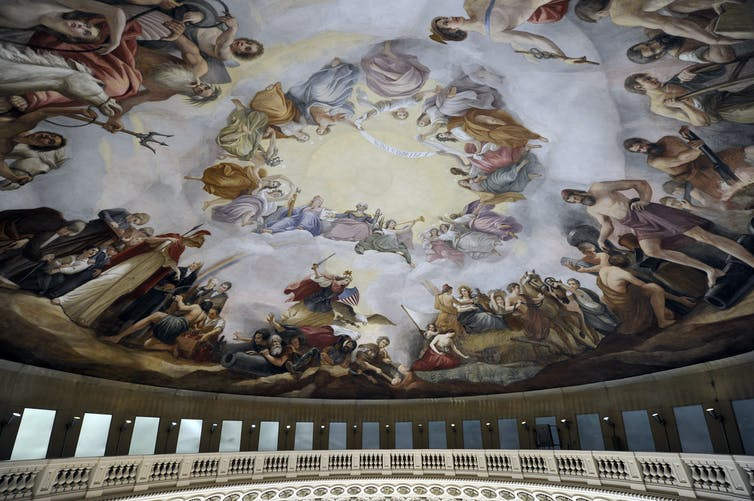 A large mural painted on a ceiling
