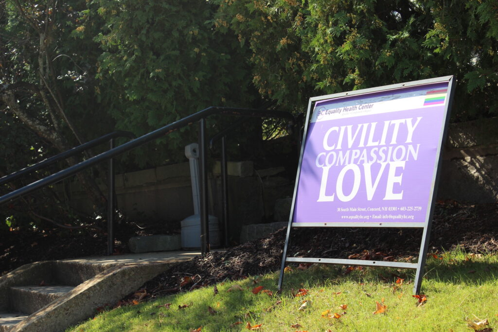 """A sign outside of a health center that says """"Civility, compassion, love"""""""